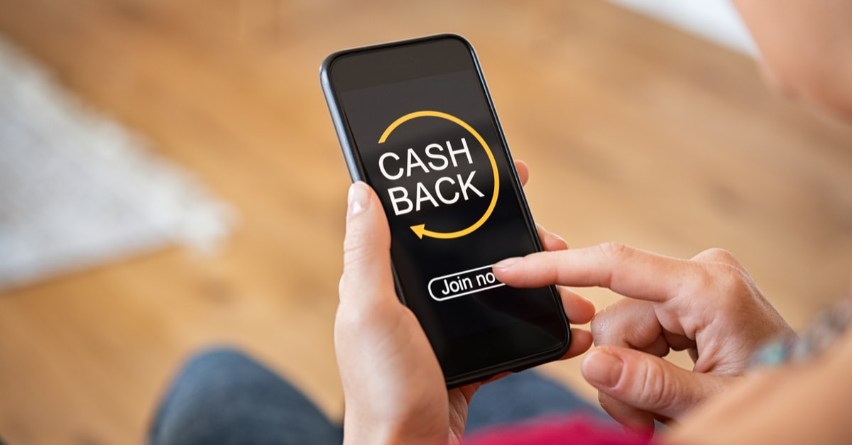 Woman taking benefit of cash back using smart phone, shopping and money refund concept.