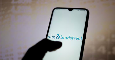In this photo illustration the Dun and Bradstreet Corporation logo seen displayed on a smartphone