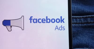 Facebook Ads logo displayed on smartphone hidden in jeans pocket