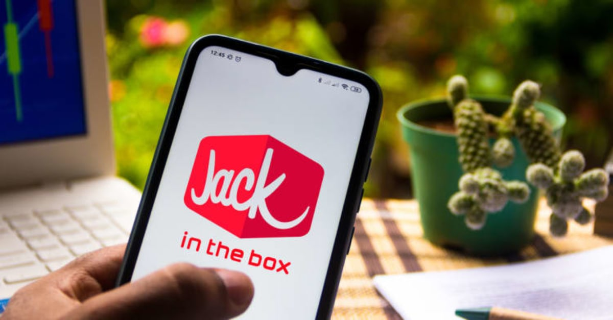 In this photo illustration the Jack in the Box logo seen displayed on a smartphone