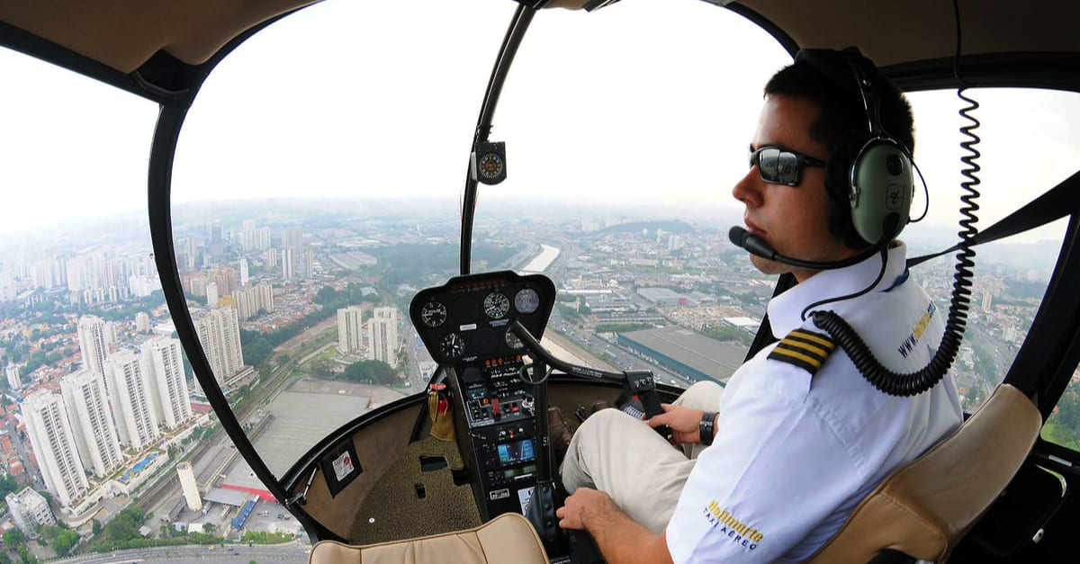 São Paulo, Brazil, February 10, 2014. Air taxi helicopter pilot flying in the city of São Paulo