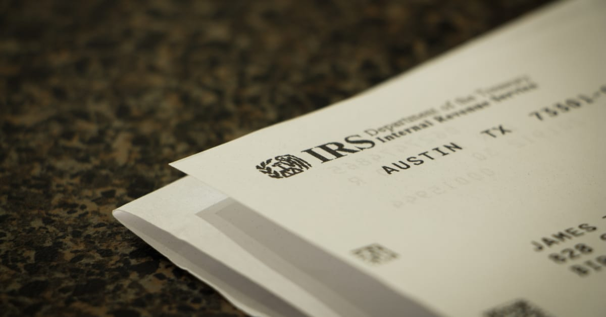 Opened letter from the IRS showing the logo on the corner of the paper with selective focus gastos deducibles irs