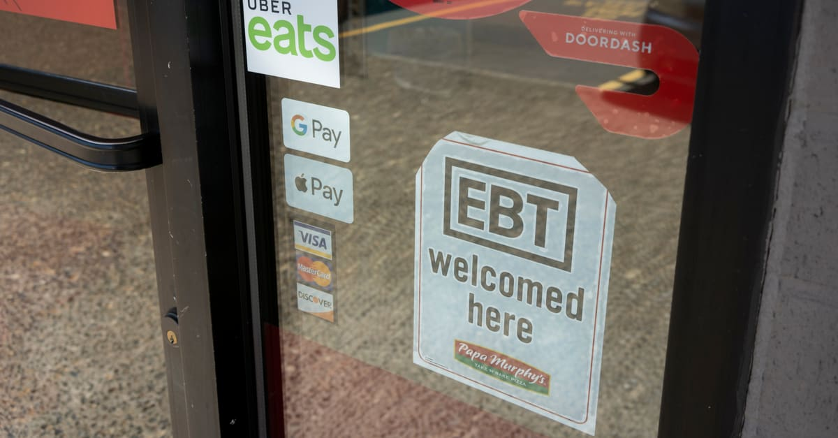 EBT Welcomed Here signage is seen at the entrance to a Papa Murphys take-and-bake pizza restaurant in Tigard, Oregon, during the COVID-19 pandemic.