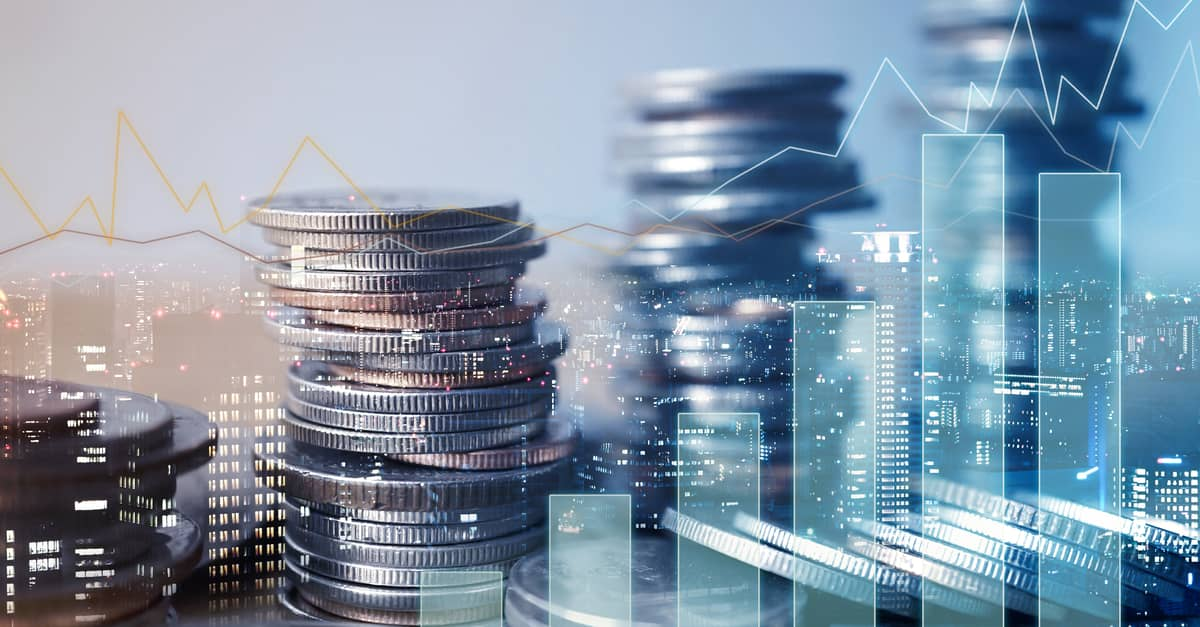Double exposure of graphs and rows of coins for financial and business concept