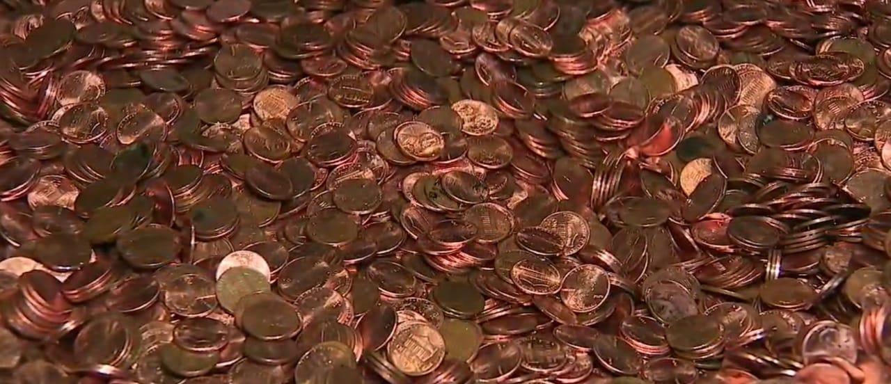 Cheque carretilla monedas