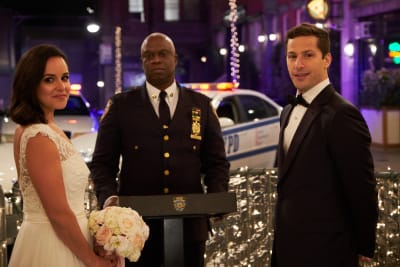 Melissa-Fumero-Andre-Braugher-and-Andy-Samberg-in-the-Jake-Amy-season-finale-episode-of-BROOKLYN-NINE-NINE
