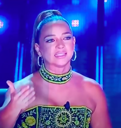 The host of Así se Baila in controversial dress