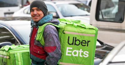 uber eats food delivery man smiles and looks on a camera on a road in Kiev, Ukraine, 7 February 2019.
