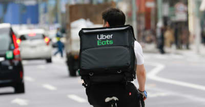 An Uber eats driver is seen at the Ginza shopping district