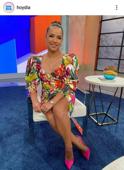 Adamari López surprises with low-cut dress and showing leg