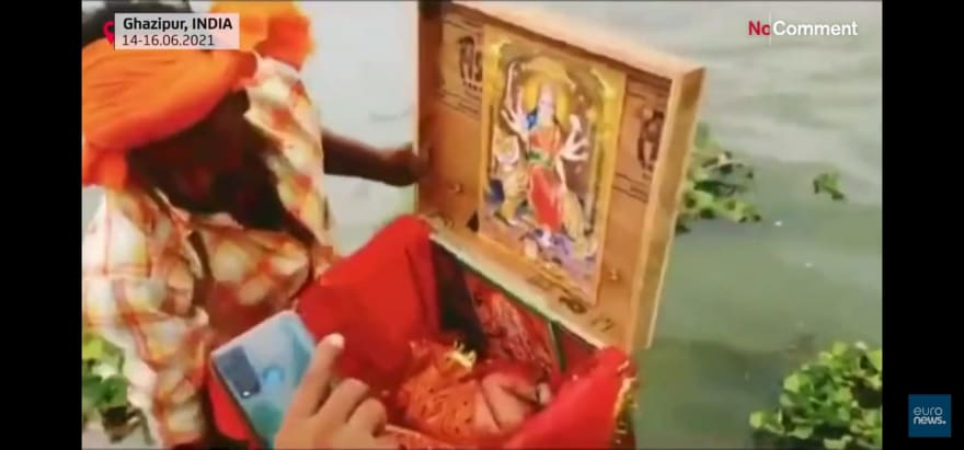 'Hero' rescues the baby from the box floating in the Ganges river