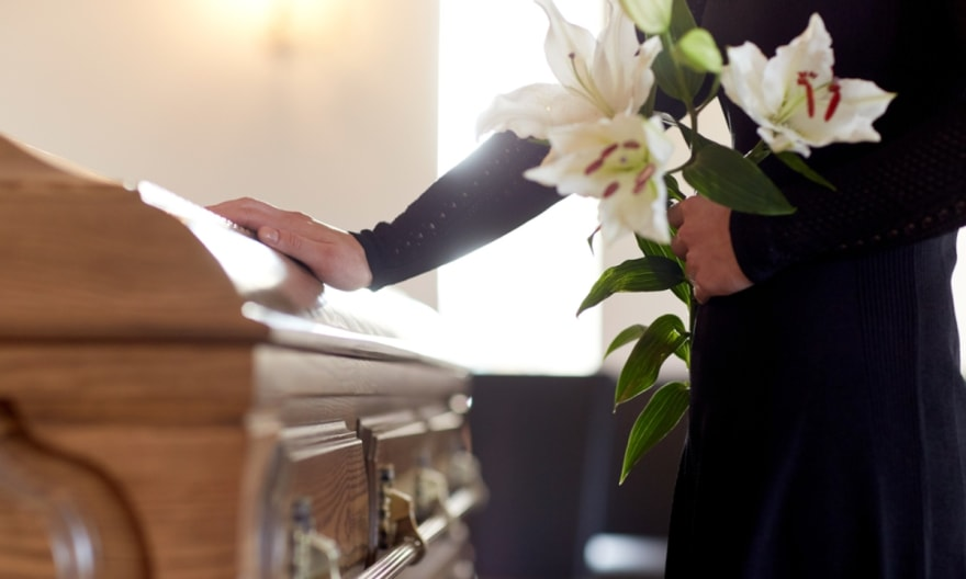 The urn is opened in the middle of the burial and the Hispanic family sues the cemetery