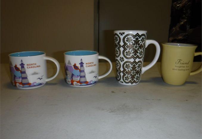 4 souvenir mugs