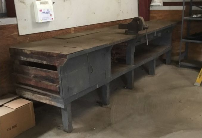 Old wooden work bench with storage
