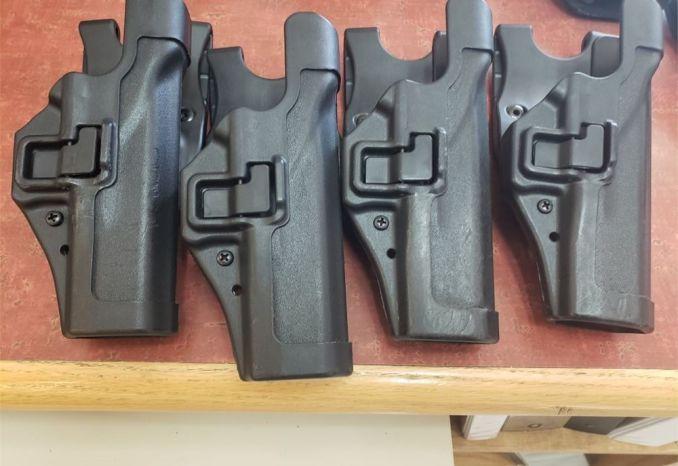 Gun holsters, batons, stop sticks, handcuffs, etc.