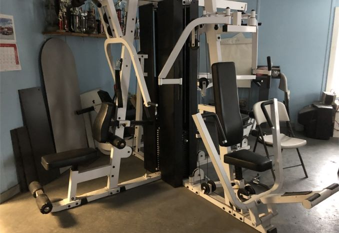 Four Station weight training machine