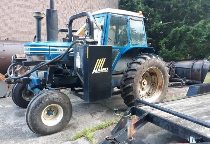 Ford 9700 with Alamo boom mower