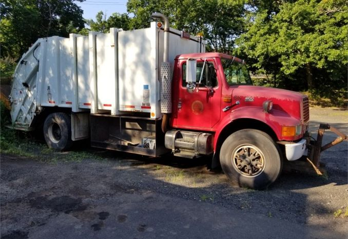 1997 International Cab & Chassis w/ rear loader trash comp.& plow