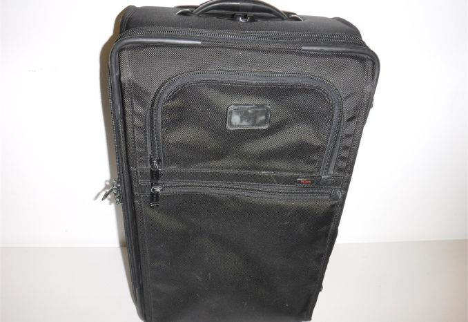 Tumi black rolling luggage (gently used as-is)