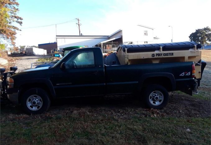 2001 GMC Sierra with sander and 8' plow.