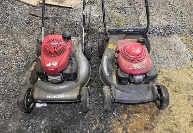 two Honda push mowers