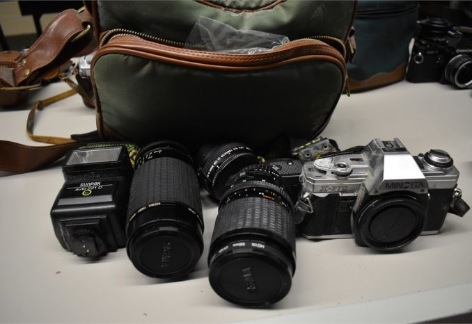 Minolta X-370 - 35 mm SLR film camera w/ lens, flash, and bag