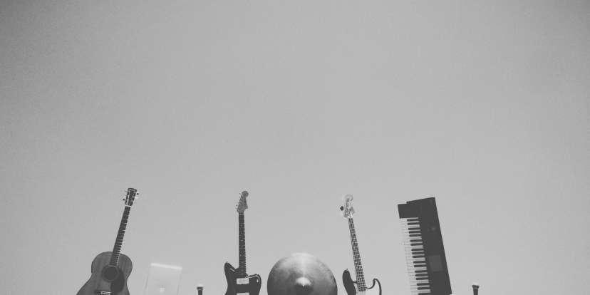 A cornucopia of guitars, bass guitars, cymbals, mics, and keyboards.