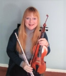 Natalie J offers violin lessons in West Seventh , MN