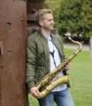 Tyler R offers saxophone lessons in Belltown, WA