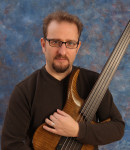 Ervin D offers bass lessons in Fort Point , MA