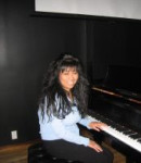 Kim B offers piano lessons in Times Square , NY
