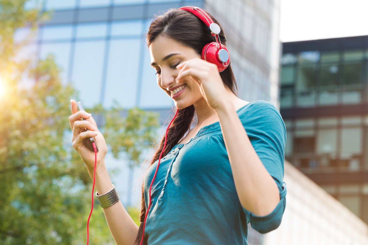 Woman listening to music on her phone