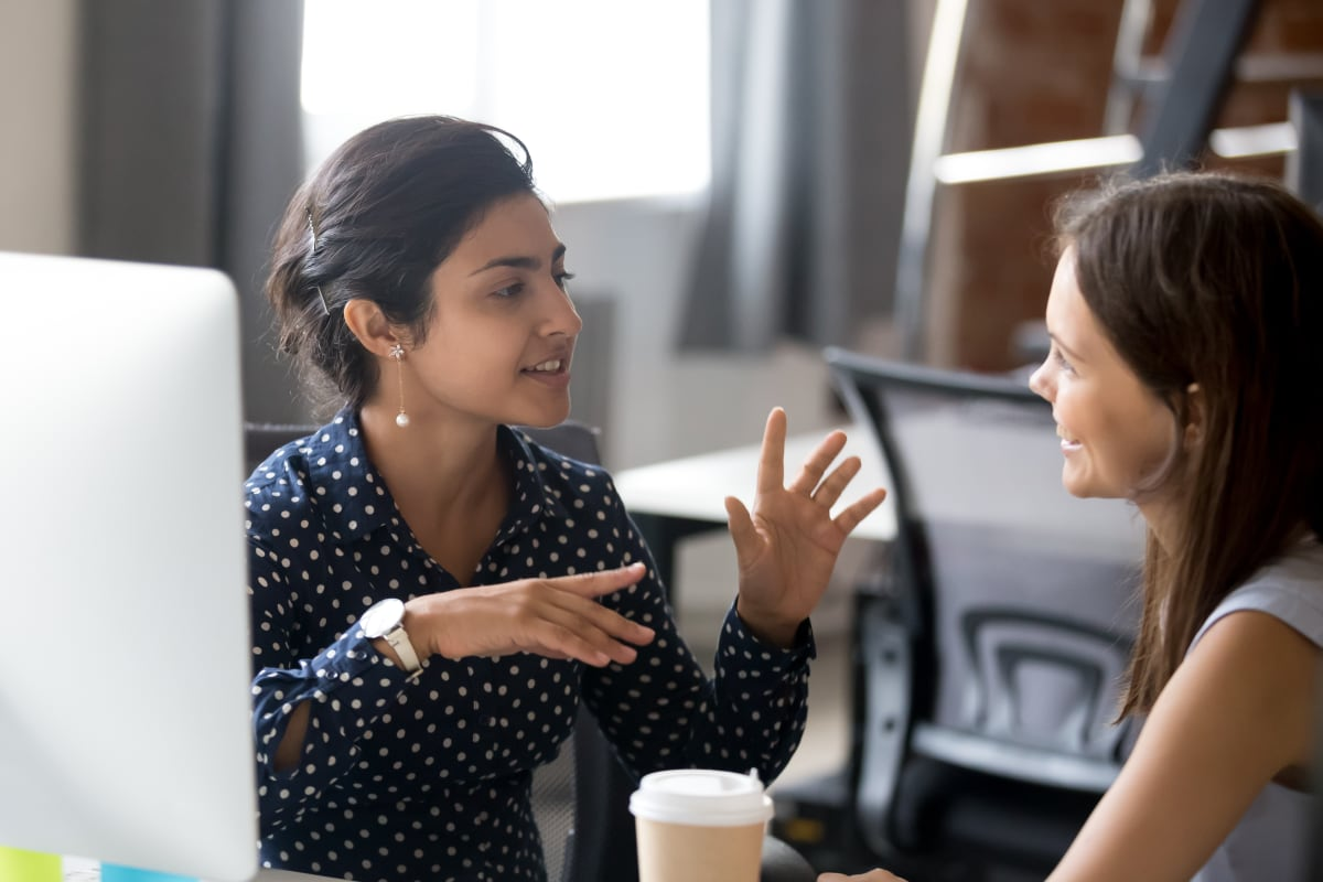 Two women talking to each other