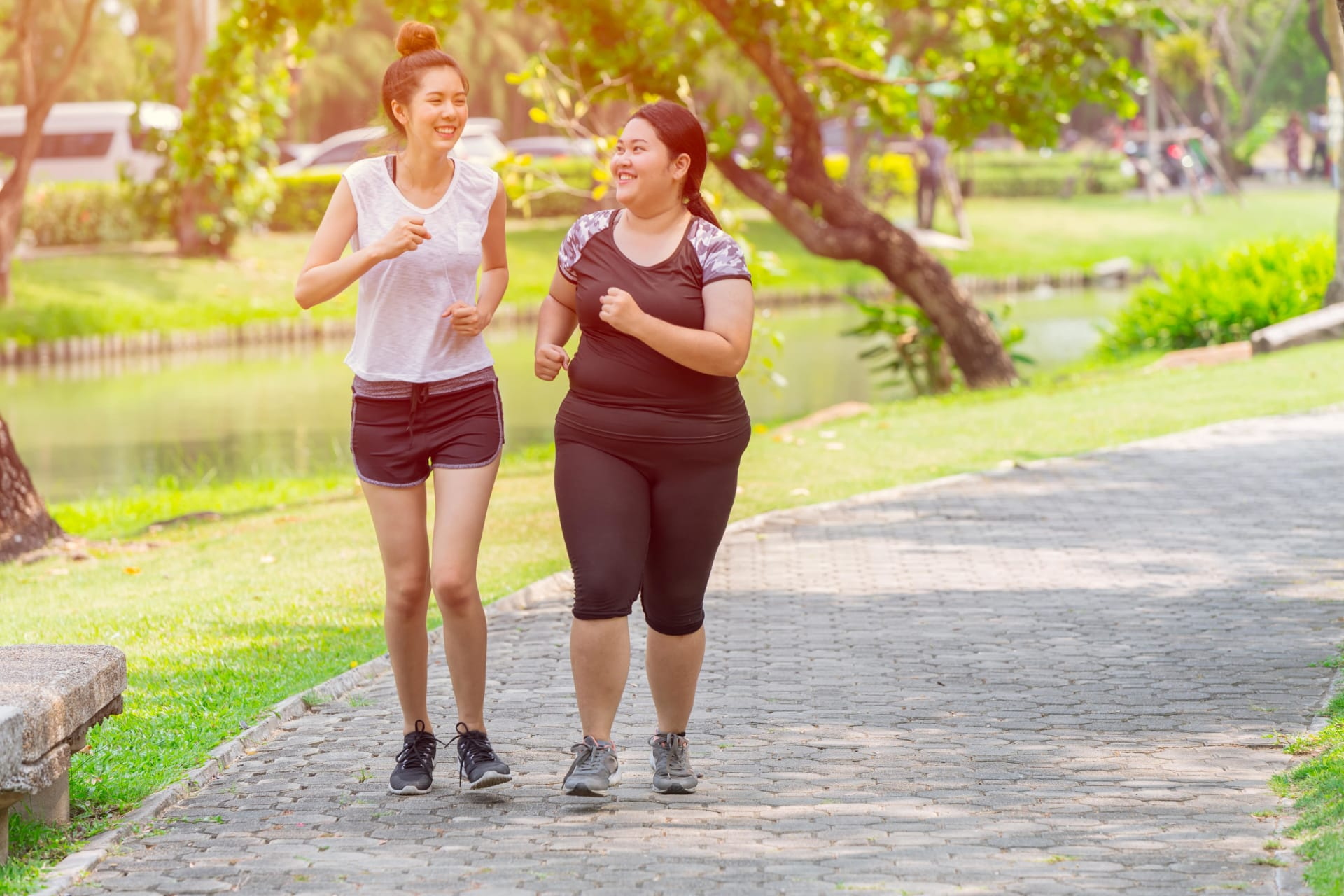Two girls running in the park