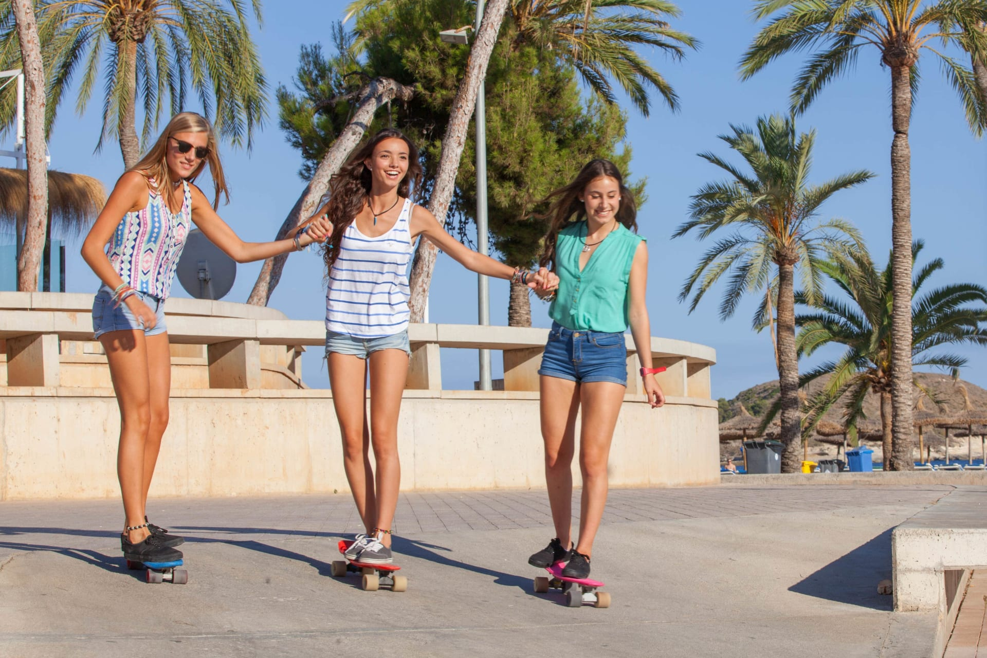 Three girls on skateboards