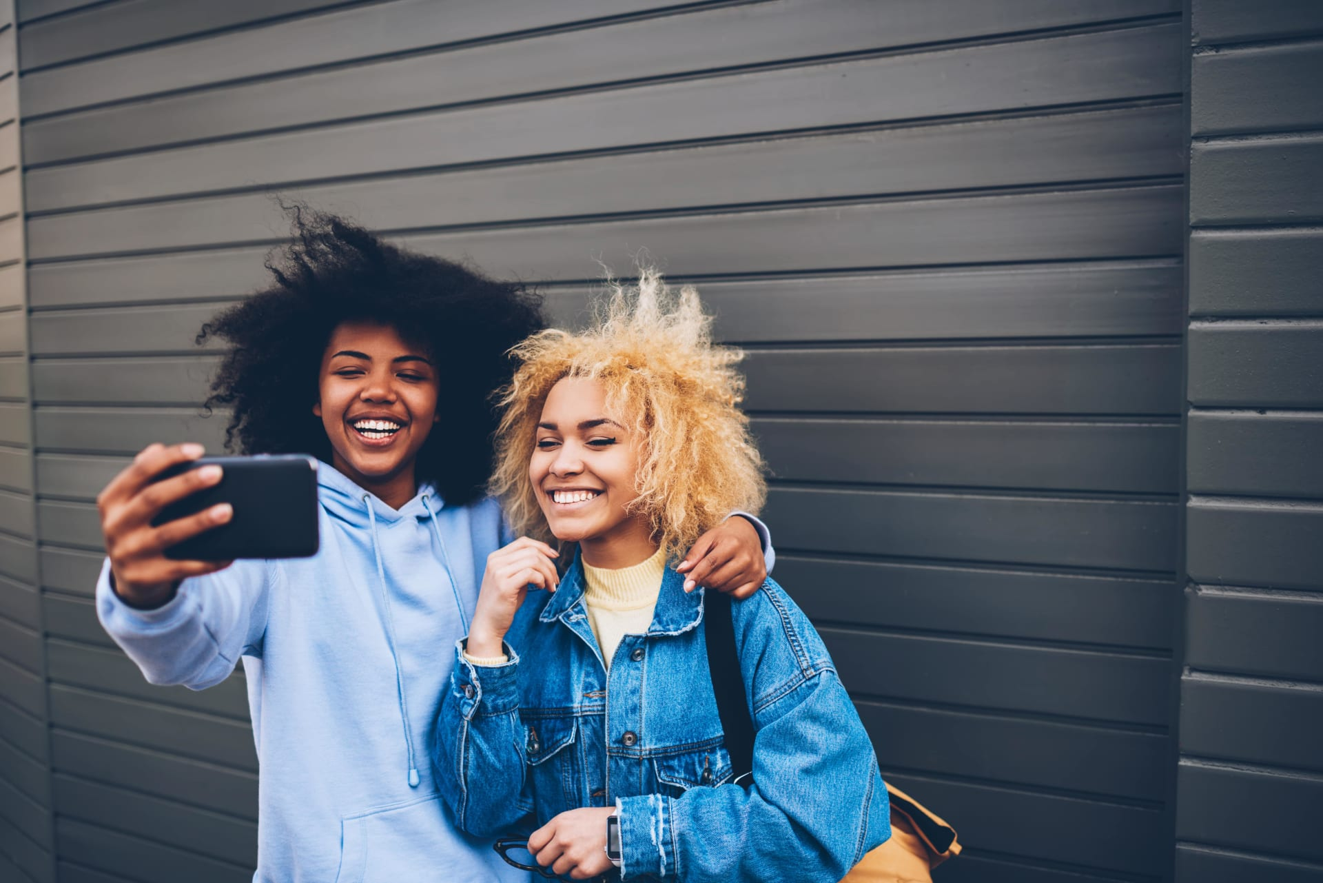 Girls smiling and taking a selfie