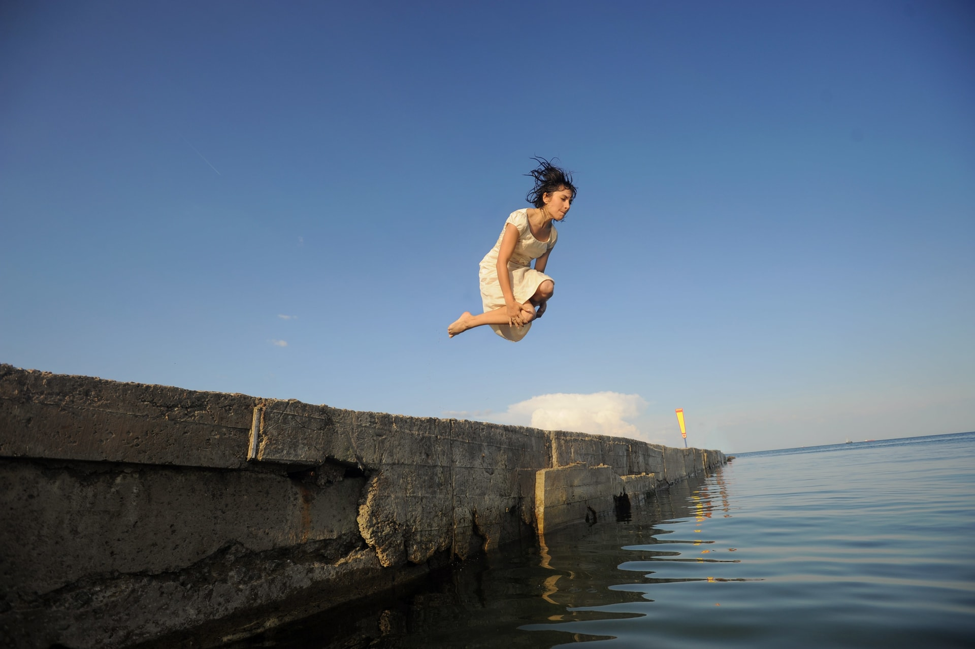 Woman jumping into the sea