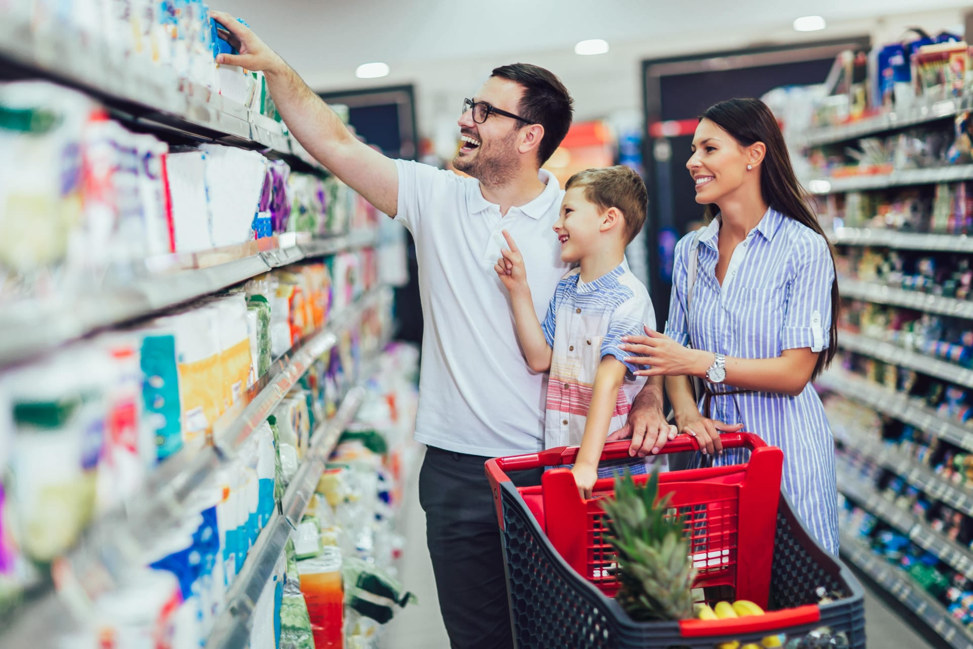 Family in a supermarket looking for period products