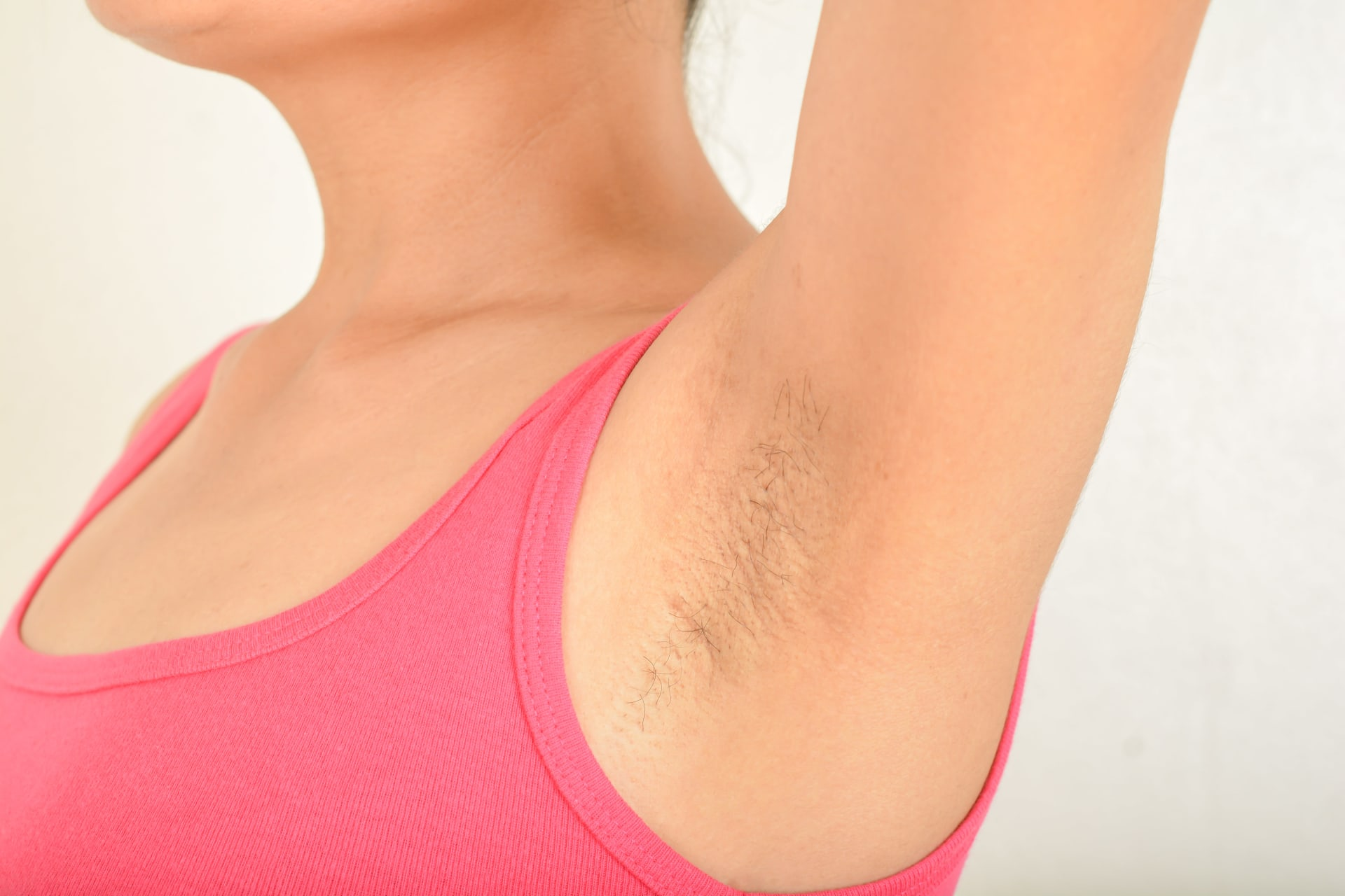 Women's armpit with hair on it