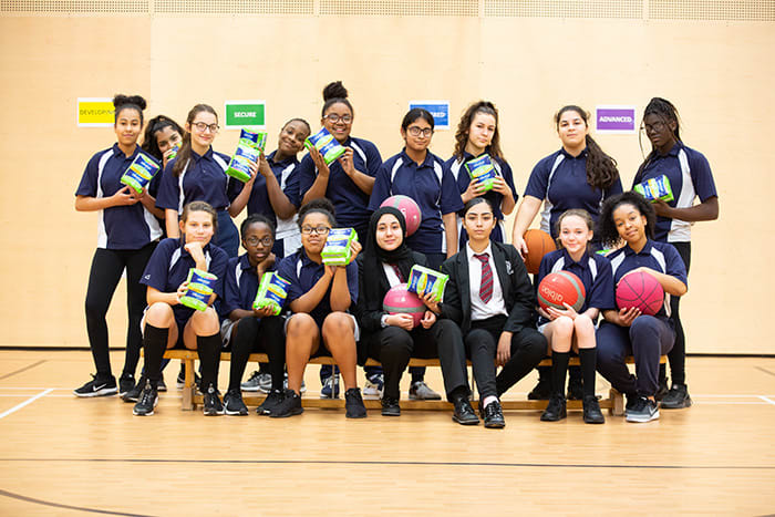 Group photo of girls holding Always Sanitary Pads packaging