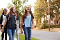 Girls walking down the street and smiling