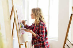 Girl painting on canvas