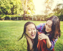 Friend hugging a friend and laughing