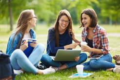 Girls sitting on grass and hanging out