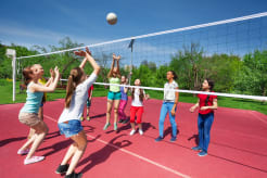 Girls playing volleyball outside