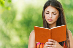 Portrait of a woman reading a book