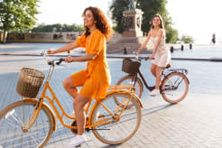 Two women riding a bicycle
