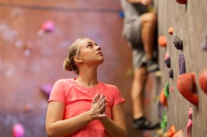 Girl next to a climbing wall