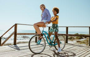 Two women riding one bicycle