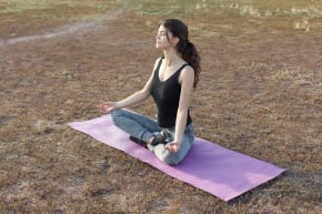 Girl in a meditation pose on the ground